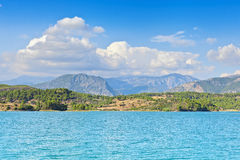 View of the coast and the mountains from the water side Royalty Free Stock Photos