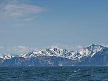View of the coast of Sakhalin Island from the mainland. Coast of the Sea of Okhotsk. Sopki Sakhalina. View of the coast of Sakhalin Island from the mainland stock photos
