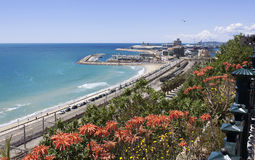 View of the coast Tarragona: sea, railway and petrochemical plan Royalty Free Stock Photos