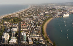 View of coast town Mount Maunganui. Wide shot view of coast town Mount Maunganui and Tauranga Harbour Royalty Free Stock Photo
