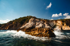 View of the coastal cliff with gulls from the open sea Royalty Free Stock Images