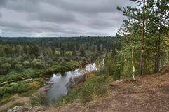 View from the coastal cliffs of the river Serga and the surrounding Ural taiga. Natural Park Deer Streams Sverdlovsk region. Stock Photo