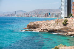View of the coastline in Benidorm. Breathtaking view of the coastline in Benidorm with high buildings, mountains, rocks and sea Royalty Free Stock Photo