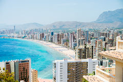 View of the coastline in Benidorm. Breathtaking view of the coastline in Benidorm with high buildings, mountains and sea Royalty Free Stock Photo