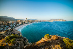 View of the coastline in Benidorm. Breathtaking view of the coastline in Benidorm with high buildings, mountains and sea Royalty Free Stock Photos