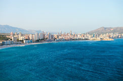 View of the coastline in Benidorm. Breathtaking view of the coastline in Benidorm with high buildings, mountains and sea Stock Photography