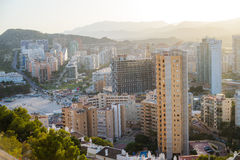 View of the coastline in Benidorm. Breathtaking view of the coastline in Benidorm with high buildings, mountains and sea Stock Images