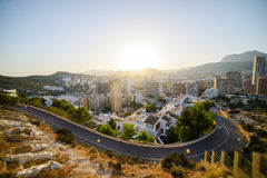 View of the coastline in Benidorm at sunset. Breathtaking view of the coastline in Benidorm at sunset with high buildings, mountains and sea Royalty Free Stock Photography
