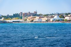 View of coastline of City of Rhodes with Grand Master palace in background Rhodes, Greece royalty free stock photography