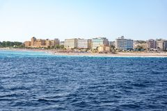 View of coastline of City of Rhodes lined with hotels on Elli beach Rhodes, Greece royalty free stock photo