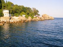 View of the coastline from the pontoon royalty free stock image
