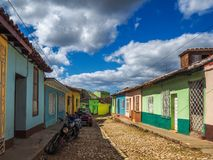 View of a cobblestone street in Trinidad. View of a cobblestone street with colorful houses in Trinidad Royalty Free Stock Photography