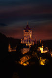 View of Cochem castle at the evening over dark sky Stock Photo