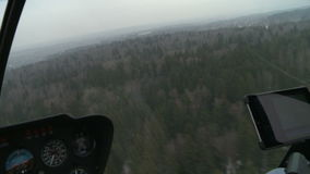 View from cockpit of helicopter flying stock footage