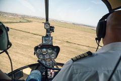 View from cockpit of Robinson R44 helicopte. DOBANOVCI, SERBIA - AUGUST 26, 2017: View from cockpit of Robinson R44 helicopter during flying, operated by Balkan Stock Photo
