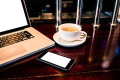 View of coffee, smartphone and laptop Stock Photos