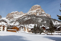 View of Colfosco, a mountain village and ski area in the Italian Dolomites, with snow Royalty Free Stock Photo
