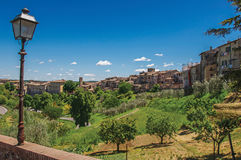 View of Colle di Val d`Elsa town with bridge and vegetation at the front. A graceful village with its historic center preserved and known by its crystal Royalty Free Stock Photos