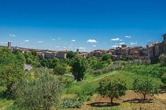 View of Colle di Val d`Elsa town with olive trees and vegetation at the front. A graceful village with its historic center preserved and known by its crystal Royalty Free Stock Images
