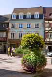 A view in Colmar city with a flower composition. Alsace, France Royalty Free Stock Photo
