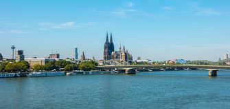 View of Cologne Cathedral along river rhine Germany. View of cologne from the rhine with hohenzollern bridge and cathedral. ideal for websites and magazines Stock Photo