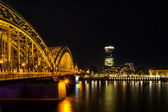 View from Cologne to Deutz at the river Rhine and the Hohenzollern train bridge at night. Royalty Free Stock Images