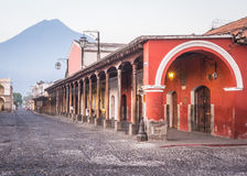 Antigua Town Centre. View of colonial buildings in central park of Antigua, Guatemala with view of Agua volcano in background Stock Images