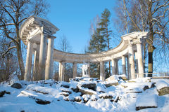 View of the colonnade of Apollo in Pavlovsk palace park on a sunny February day. Saint Petersburg. View of the colonnade of Apollo in Pavlovsk palace park on a royalty free stock images