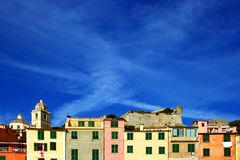 View of the colored buildings with castle and the cathedral of Portovenere Stock Image