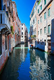 View of colored venice canal with houses standing in water Royalty Free Stock Photo