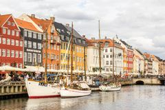 View of colorful building at Nyhavn waterfront. COPENHAGEN, DENMARK - JUNE 18 2018: View of Nyhavn waterfront with colorful buildings and boats in the canal on stock photo