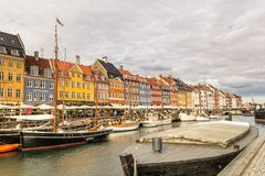 View of colorful building at Nyhavn waterfront. COPENHAGEN, DENMARK - JUNE 18 2018: View of Nyhavn waterfront with colorful buildings and boats in the canal on stock images
