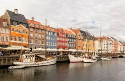 View of colorful building at Nyhavn waterfront. COPENHAGEN, DENMARK - JUNE 18 2018: View of Nyhavn waterfront with colorful buildings and boats in the canal on stock photography