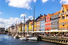 View of colorful building at Nyhavn waterfront. COPENHAGEN, DENMARK - JUNE 17 2018: View of Nyhavn waterfront with colorful buildings and boats in the canal on stock images