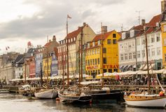 View of colorful building at Nyhavn waterfront. COPENHAGEN, DENMARK - JUNE 18 2018: View of Nyhavn waterfront with colorful buildings and boats in the canal on royalty free stock photos