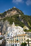 View of colorful buildings along seaside in Amalfi, a town in the province of Salerno, in the region of Campania, Italy, on the Gu Stock Photo