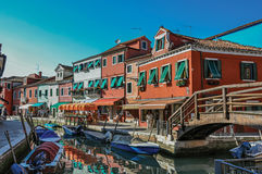 View of colorful buildings, bridge and people at Burano. royalty free stock image