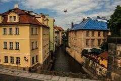 A view of the buildings in the historical part of Prague, Mala Strana Lesser Town, shot from the Charles Bridge. A view of colorful buildings located in the Royalty Free Stock Image