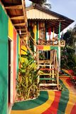 The view on the colorful house and road in jungle. Stock Photos