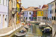 View of colorful houses in a day near the water canal at the Burano island near venice Stock Images