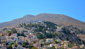 View of colorful houses on a hill in Simi island Stock Photo