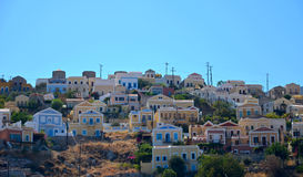 View of colorful houses on a hill in Simi island between Greece and Turkey Royalty Free Stock Image