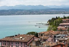 View of colorful old building in Sirmione and Lake Garda from Scaliger castle wall, Stock Image