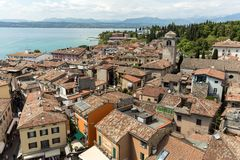 View of colorful old building in Sirmione and Lake Garda from Scaliger castle wall. Italy stock image