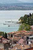 View of colorful old building in Sirmione and Lake Garda from Scaliger castle wall, Stock Photo