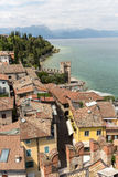 View of colorful old buildings in Sirmione and Lake Garda from Scaliger castle wall, Stock Image