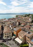 View of colorful old buildings in Sirmione and Lake Garda from Scaliger castle wall, Stock Images