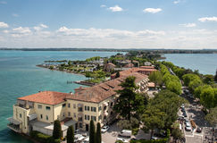 View of colorful old buildings in Sirmione and Lake Garda from Scaliger castle wall, Italy Stock Image
