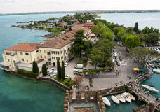 View of colorful old buildings in Sirmione and Lake Garda from Scaliger castle wall, Royalty Free Stock Images