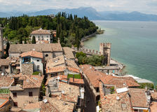 View of colorful old buildings in Sirmione and Lake Garda from Scaliger castle wall, Stock Photography